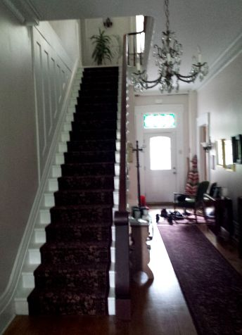 The main hallway connects front and back entrances.