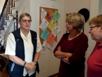 Owner Jan Carr chats with visitors at the anniversary open house.