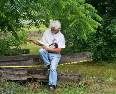 A guest playing with Prince under the walnut tree.