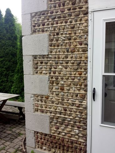 Corner of the patio shows cobble detail.