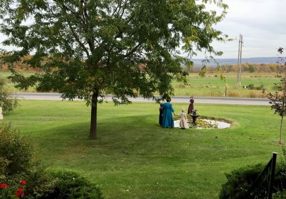 Guests at the Open House check out the front fountain, fall 2017.