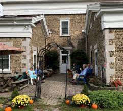 Guests enjoy the courtyard patio; Open House October 22, 2017.