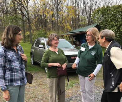 Anne Meyer-Wilber and Jan Carr, right, greet guests at the 2017 Open House.